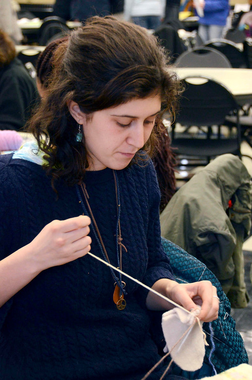 . Jessica Sweeney, of North Adams, sews mittens for children in the North Adams Public Schools and Northern Berkshire Headstart, during the 2014 MLK Jr. \'Day of Service\' at the MCLA Church Street Center on Monday, Jan. 20, 2014. (Gillian Jones/Berkshire Eagle Staff)