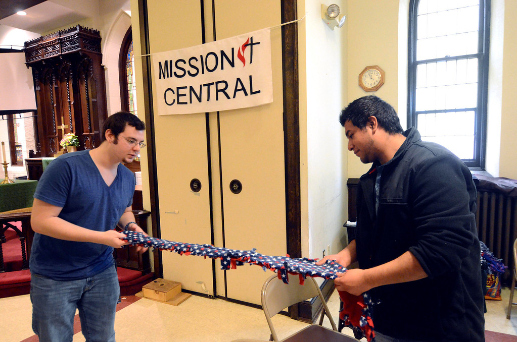 . Daniel Rafferty and Salvador Bravo, of BCC, make a scarf during a day of service for Martin Luther King Jr. Day at the First United Methodist Church in Pittsfield on Monday, Jan. 20, 2014.  (Ben Garver / Berkshire Eagle Staff)