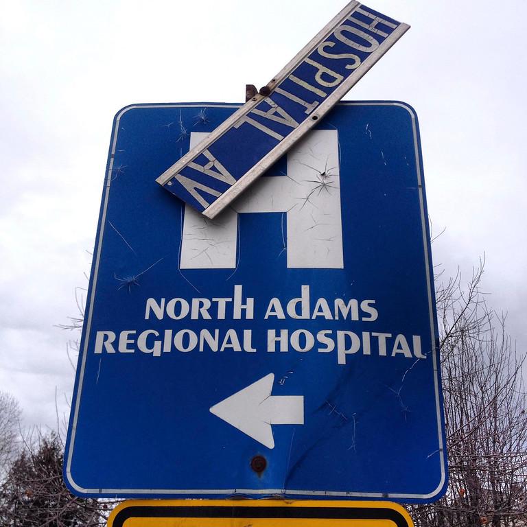 . The street sign on Hospital Ave. in North Adams hangs broken.  Wednesday March 26, 2014.  Ben Garver / Berkshire Eagle Staff / photos.berkshireeagle.com