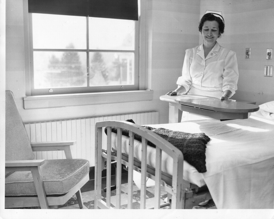 . 1955 Berkshire Eagle file photo at North Adams Hospital showing a nurse in a patient room.