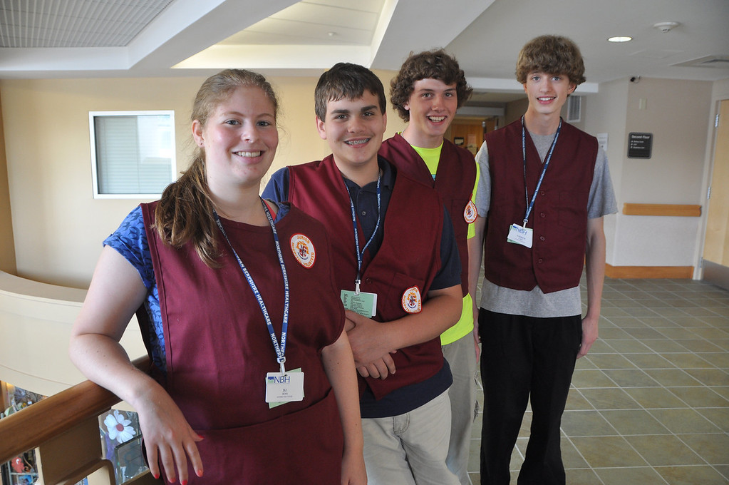 . NARH junior volunteers are from left, DJ Ross, 17, Blaize Pandell, 13, Travis Ciempa, 15, and Andrew Corsi, 15. August 1, 2012. File photo by Gillian Jones