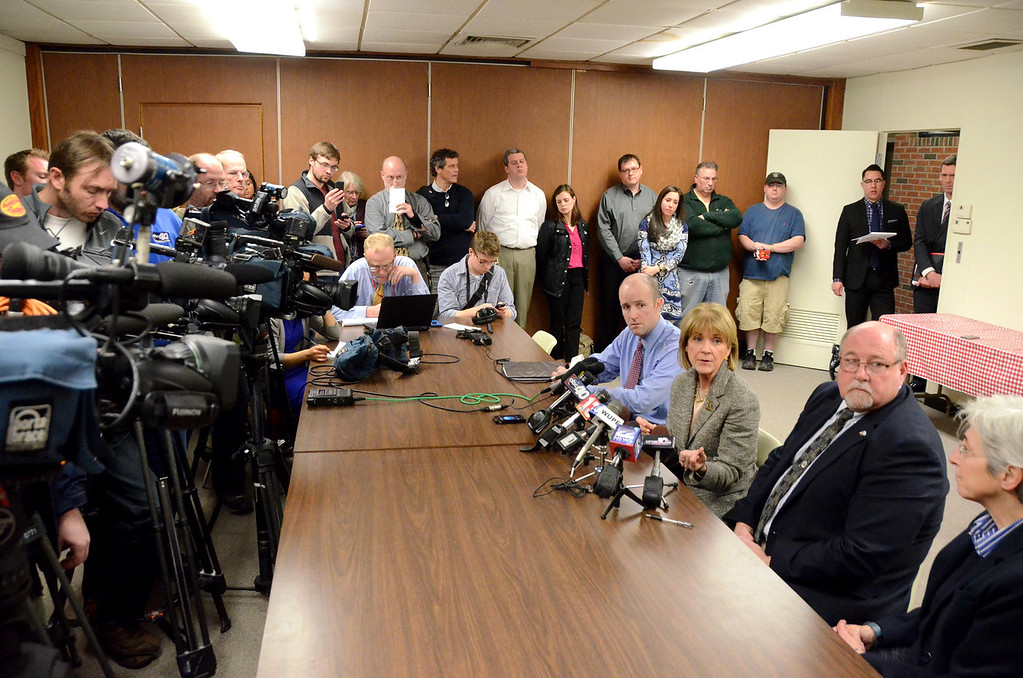 . Attorney General Martha Coakley speaks to the media in North Adams City Hall after meeting with State Senator Benjamin Downing, left, Mayor Richard Alcombright, right, and State Representative Gailanne Cariddi, far right, on Tuesday, April, 1, 2014. Gillian Jones / Berkshire Eagle Staff / photos.berkshireeagle.com