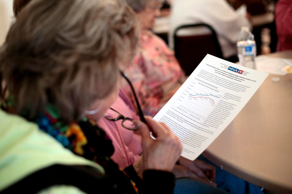 . Susan Frew reads a financial analysis of the time leading up to the hospital\'s closure at a meeting of former NARH employees and community members at the American Legion in North Adams. Tuesday, May 6, 2014. Stephanie Zollshan / Berkshire Eagle Staff / photos.berkshireeagle.com