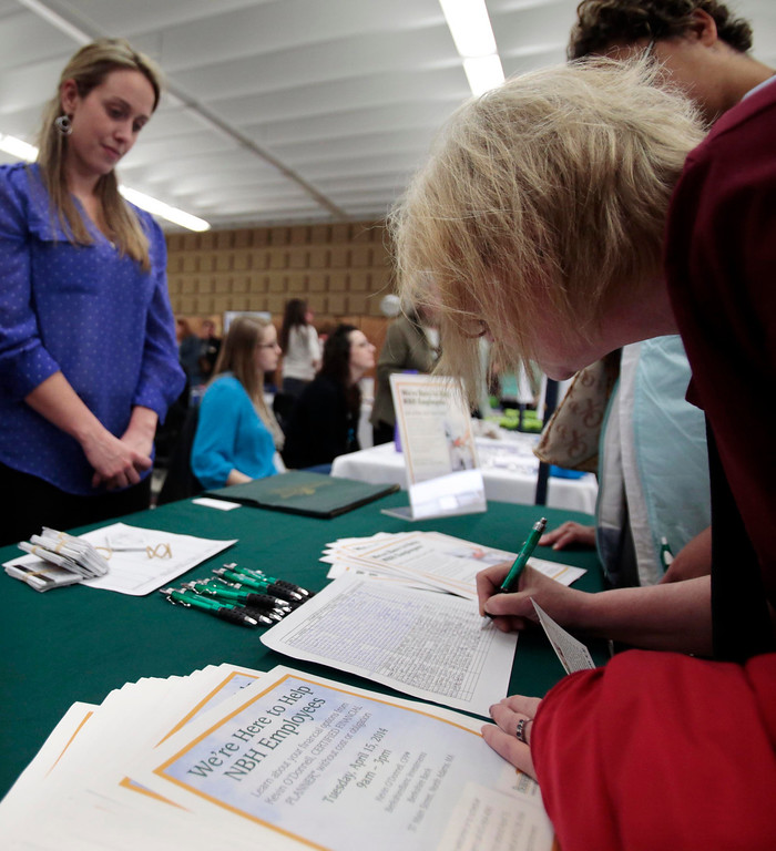 . Joan Thomas, right, a former employee in the billing department at North Adams Regional Hospital (NARH), signs up for free financial advising services from Berkshire Bank at a community resource fair for the former NARH employees is held in the Church Street Center social hall on the MCLA campus. Friday, April 11, 2014. Stephanie Zollshan / Berkshire Eagle Staff / photos.berkshireeagle.com