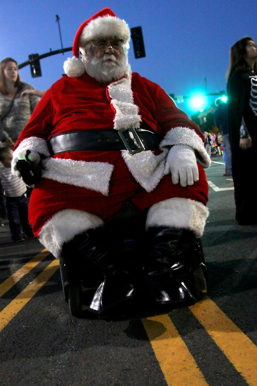 . Ken Keefner, rides through North St. in Pittsfield Dressed as Jolly ol\' St. Nicholas during the 3rd thursday evernt in Pittsfield held on North St. The theme was Moster Mash, guests were invited to wear their scariest costumes. 10/17/13 Holly Pelczynski/Berkshire Eagle Staff