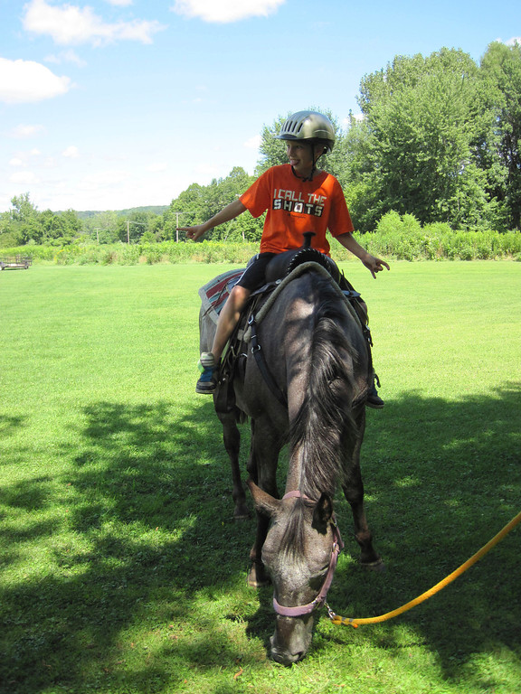 . Nine-year-old Zack Lillie of Adams busts out some disco dance moves on the back of Stella the Appaloosa. Horse rides were offered as part of the Adams Youth Center\'s annual family fun day held Sunday at The Range in North Adams. Jenn Smith/Berkshire Eagle Staff Sunday, Aug. 11, 2013