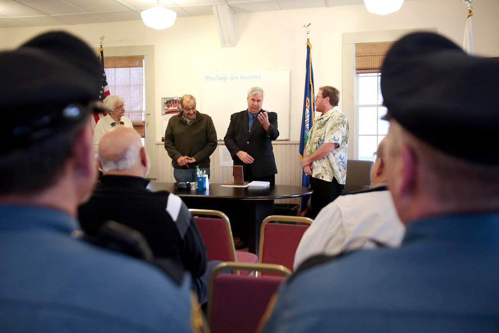 . Retired Great Barrington Fire Chief Michael Ordyna receives a Life Saving Medal from the Monterey Select Board at Town Hall in Monterey for saving the life of a woman who hit her head and fell into the water at Lake Buel in July. Monday, November 18, 2013. (Stephanie Zollshan | Berkshire Eagle Staff)