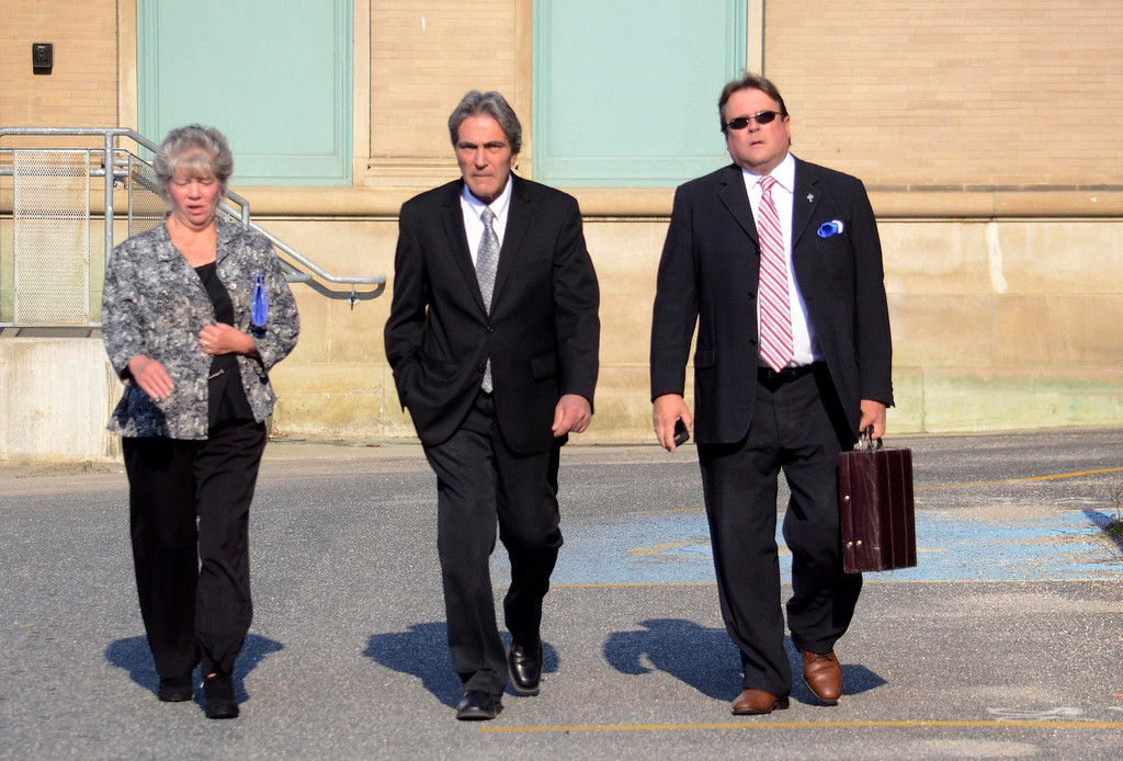 . Paul Capitanio (center) approaches Berkshire Centeral District Court With his wife Beth and Attorney Timothy J. Shugrue, Tuesday August 20, 2013.  Ben Garver / Berkshire Eagle Staff