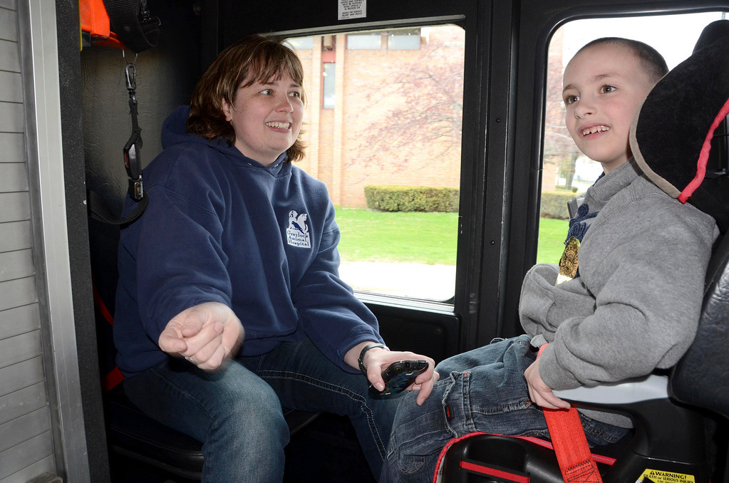 . Brayton Elementary School first grader Zach Hillard, 7, rides in a North Adams Firetruck with his mother, Dr. Heather Blake, on Tuesday, April, 29, 2014. Gillian Jones / Berkshire Eagle Staff / photos.berkshireeagle.com