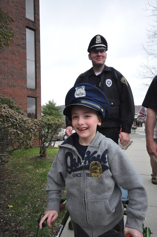 . Brayton Elementary School first grader Zach Hillard, 7, who has cerebral palsy, had his wish come true on Tuesday, April, 29, 2014. Hillard, who is undergoing major surgery in June, got the chance to spend the morning with North Adams Police Officer Mark Bailey, ride in a police cruiser, arrest his mother, tour the police and fire departments, meet the Mayor, and ride in a North Adams Fire Department truck. Zach walks into North Adams City Hall. Behind him is Officer Bailey. Gillian Jones / Berkshire Eagle Staff / photos.berkshireeagle.com