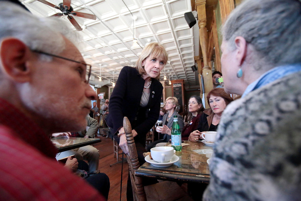 . Martha Coakley listens to a question from Berkshire Brigade member Tommie Hutto-Blake at Dottie\'s Coffee Lounge in Pittsfield during a tour of Massachusetts cities to announce her candidacy for governor. Tuesday, September 17, 2013. Stephanie Zollshan/Berkshire Eagle Staff.