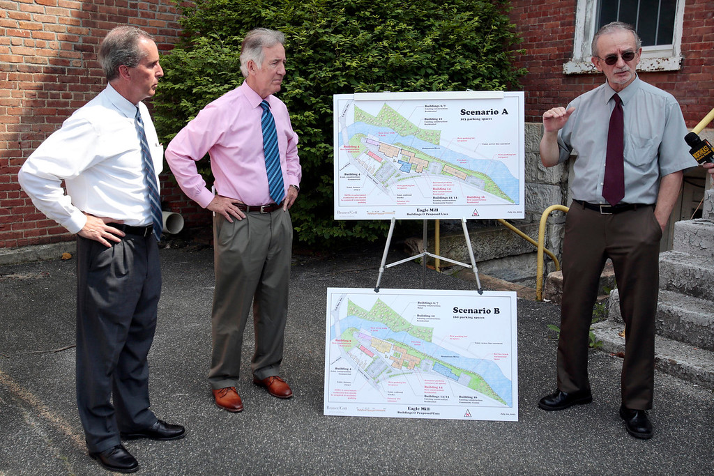 . Richard Vinette, right, a consultant for the developer, talks about the upcoming Eagle Mill Complex details with Rep. William \'Smitty\' Pignatelli, left, and Congressman Richard Neal, center, as they announce a $115,000 EPA Brownfield Grant for the mill complex in Lee on Tuesday, June 17, 2014. Stephanie Zollshan / Berkshire Eagle Staff / photos.berkshireeagle.com