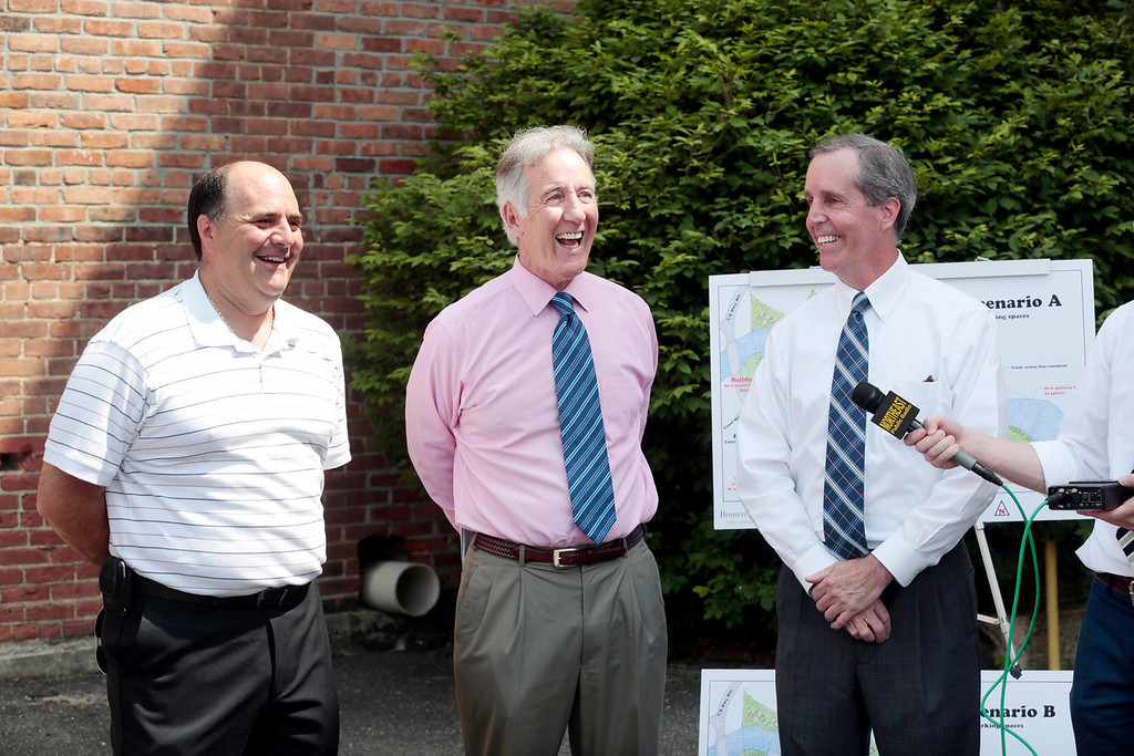 . Lee Board of Selectmen chair David Consolati, left, talks about the upcoming Eagle Mill Complex details with Rep. William \'Smitty\' Pignatelli, right, and Congressman Richard Neal, center, as they announce a $115,000 EPA Brownfield Grant for the mill complex in Lee on Tuesday, June 17, 2014. Stephanie Zollshan / Berkshire Eagle Staff / photos.berkshireeagle.com