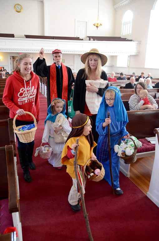 . Clockwise from left, Rachael Roche, Rev. Joel H. Huntington, Ann Roche, Lucy Garrison, 8, Jace Coco, 3, and Molly Isham-Morton lead a procession into church during the celebration service for the church\'s capital campaign at the South Congregational Church in Pittsfield on Sunday, March, 16, 2014. The procession was a re-enactment of the journey of Abraham and Sarah. Gillian Jones / Berkshire Eagle Staff / photos.berkshireeagle.com