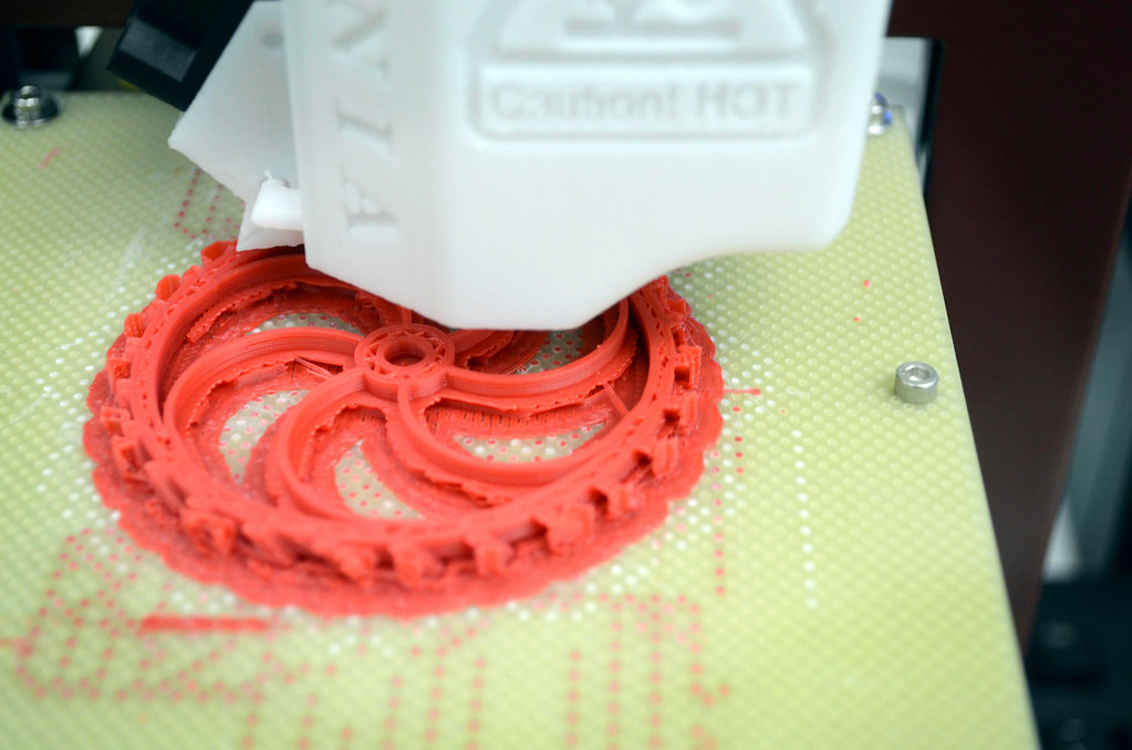 . A 3-D printer creates a plastic gear at Taconic High School in Pittsfield.  Tuesday October 1, 2013. Ben Garver / Berkshire Eagle Staff