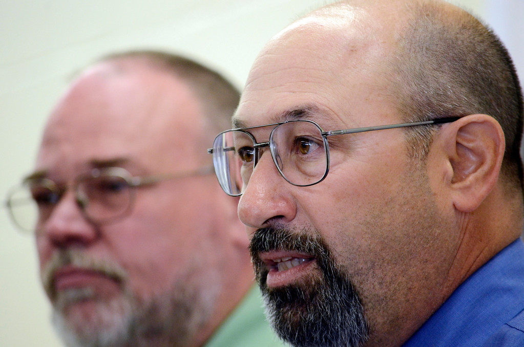 . Taconic vocational teachers Larry Micalenko (left) and Mark Lausier speak at Taconic High School during the unveiling of state-of-the-art manufacturing equipment at the school , Tuesday October 1, 2013. Ben Garver / Berkshire Eagle Staff