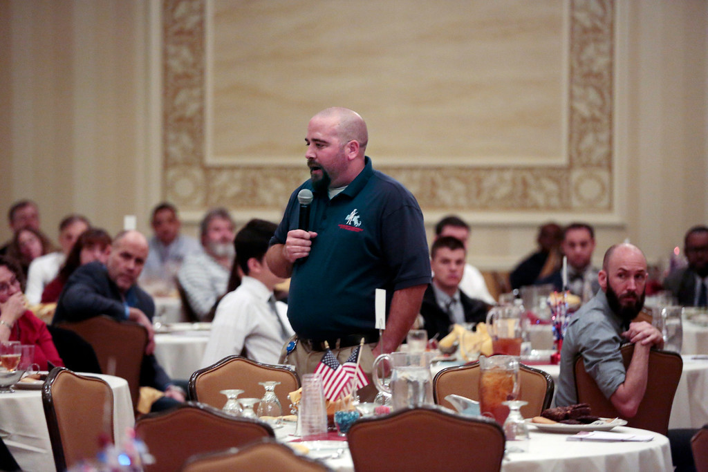 . Keynote speaker Gabe Nutter addresses attendees at the Veteran\'s Expo at the Crowne Plaza hotel in Pittsfield. Friday, November 15, 2013. (Stephanie Zollshan | Berkshire Eagle Staff)