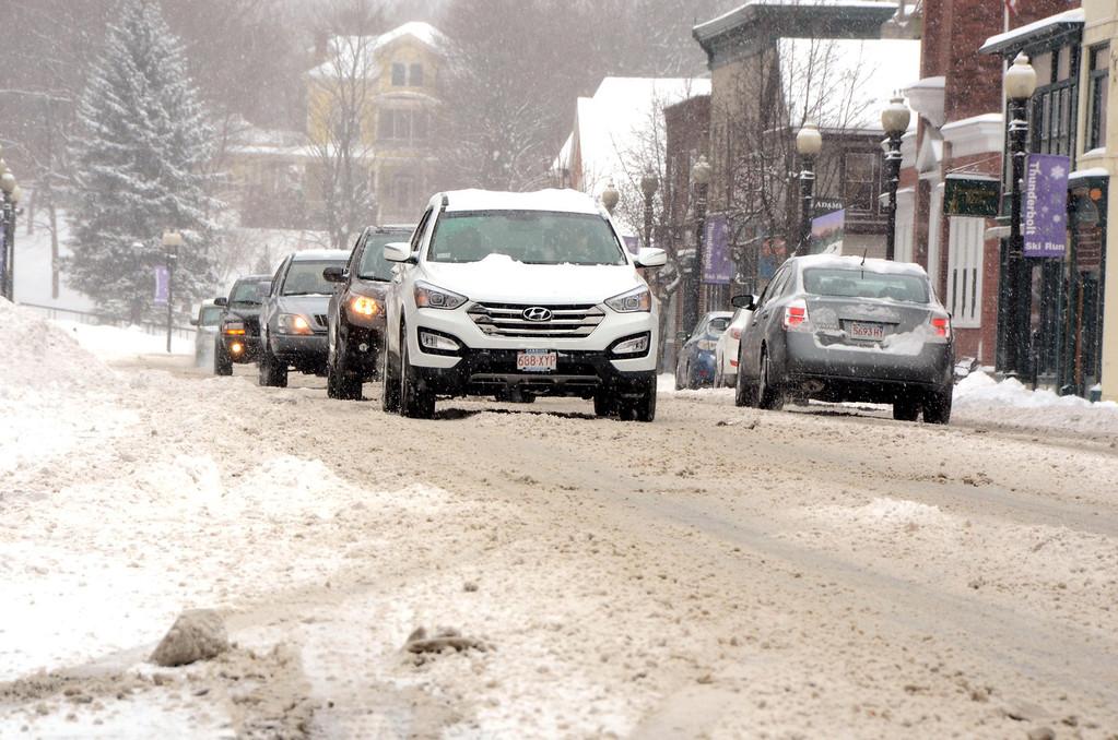 . Motorists navigate snow covered roads on Park Street in downtown Adams on Wednesday, Feb. 5, 2014. Gillian Jones/Berkshire Eagle Staff