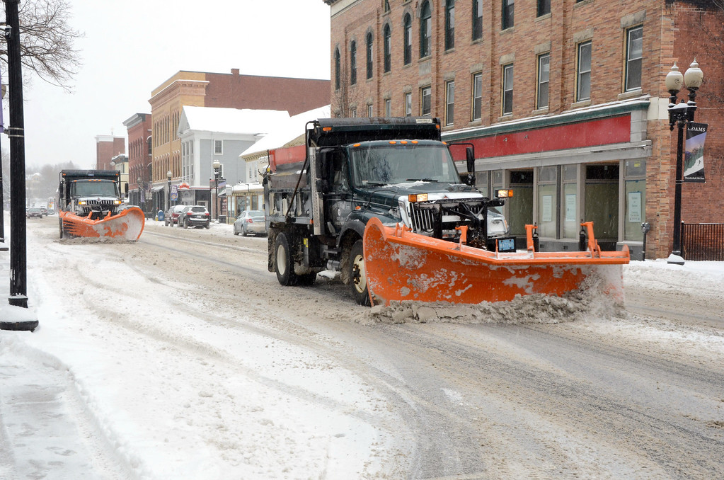 . A couple of snowplows work in tandem as they clear Park Street in Adams on Wednesday, Feb. 5, 2014. Gillian Jones/Berkshire Eagle Staff