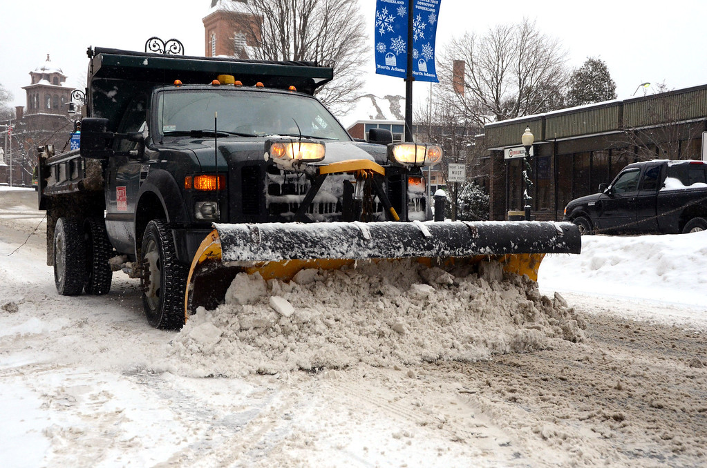 . A snowplow clears the westbound lane of Main Street in downtown North Adams on Wednesday, Feb. 5, 2014. Gillian Jones/Berkshire Eagle Staff