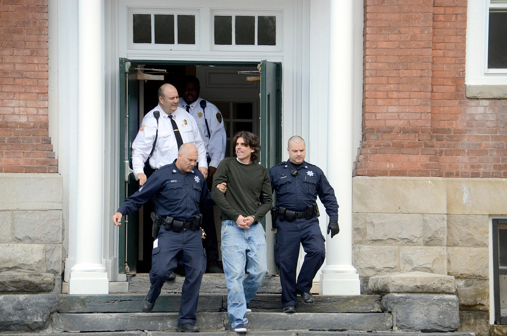 . Christopher Blair is led out of  South Berkshire District Court (Great Barrington) after his arraignement for the robbery of the Lee Bank branch in Stockbridge, Thursday March 20, 2014.  Ben Garver / Berkshire Eagle Staff / photos.berkshireeagle.com