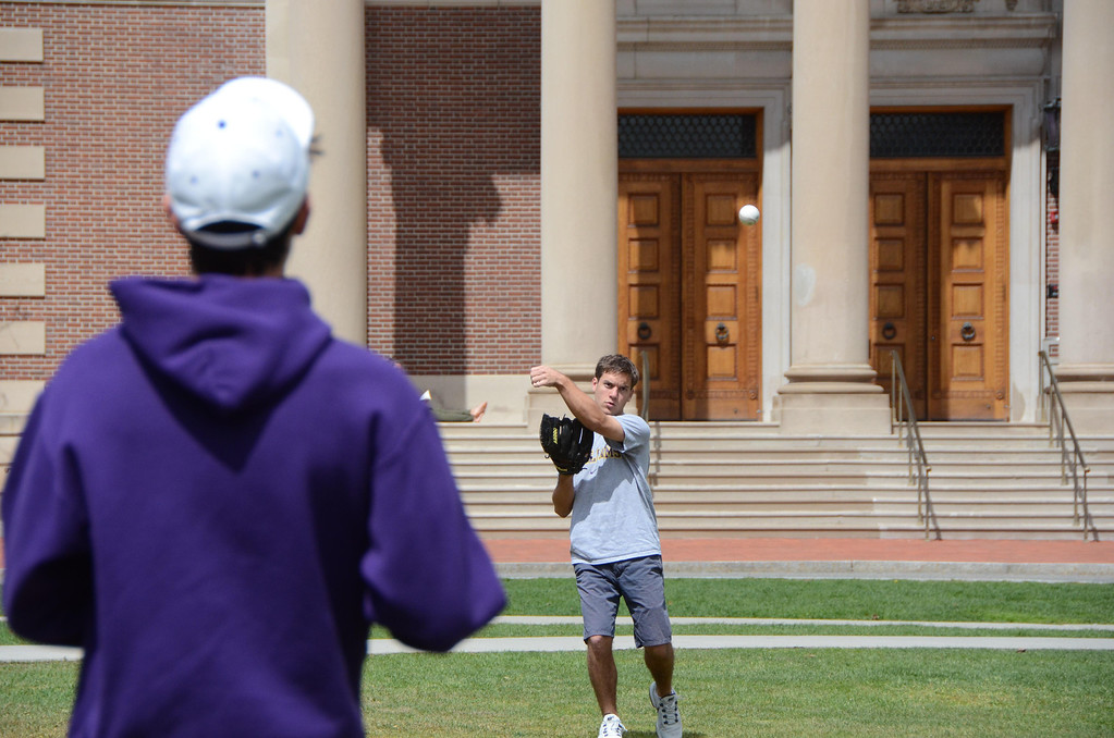 . Williams College students Michael Stone, left, of Los Angeles, CA and Jonathan Dely of Cold Spring Harbor, NY, play a little catch on Chapin Lawn on Monday afternoon as temperatures started to rise. The two students actually are on the college\'s golf team. Gillian Jones / Berkshire Eagle Staff / photos.berkshireeagle.com