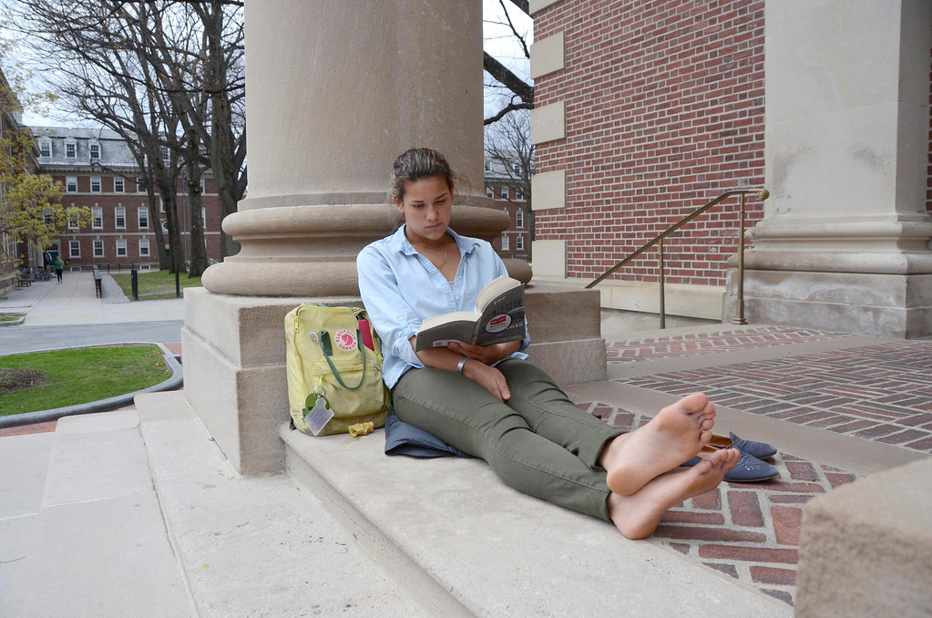 . Williams College student Avery Pagan  of New York City, reads a book for her history class as she enjoys the warm weather and sits on the steps of Chapin Hall on the college campus on Monday, May, 5, 2014. According to Pagan, the students refer to the steps of Chapin as Chapin Beach. Gillian Jones / Berkshire Eagle Staff / photos.berkshireeagle.com