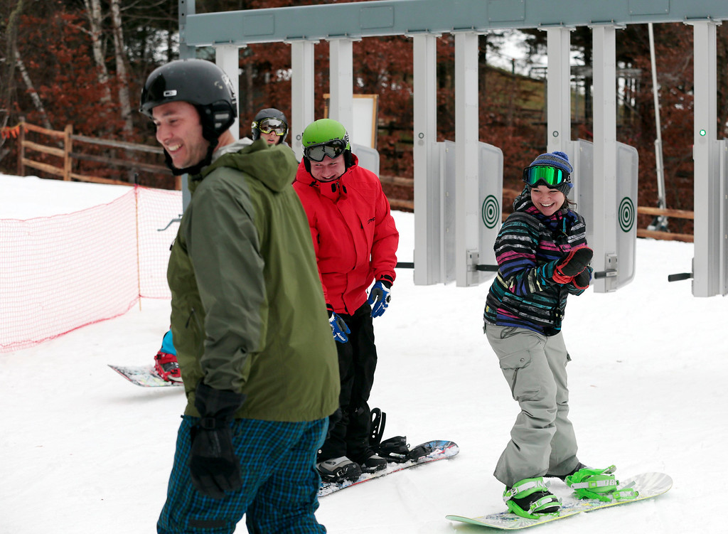 . Though grass still covers most of the mountain, ski and snowboard enthusiasts take to the slopes on opening weekend of Jiminy Peak in Hancock. Sunday, November 17, 2013. (Stephanie Zollshan | Berkshire Eagle Staff)