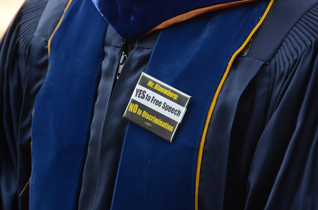 . In a silent protest of Former NYC Mayor Michael Bloomberg speaking at graduation exercises at Williams college\'s 225th commencement, students and faculty wore these pins, on Sunday, June, 8, 2014. Gillian Jones / Berkshire Eagle Staff / photos.berkshireeagle.com