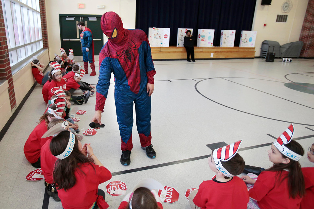 . Spiderman asks Elena Iovieno to answer a bullying question at Williams Elementary School in Pittsfield during an anti-violence and anti-bullying program. Wednesday, March 26, 2014. Stephanie Zollshan / Berkshire Eagle Staff / photos.berkshireeagle.com