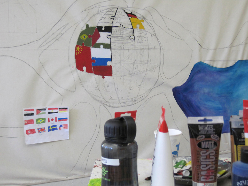 . Students in the summer session of Artsbridge, hosted by Buxton School in Williamstown, are creating this mural of many nations. The Artsbridge program uses art and dialogue to develop constructive partnerships between Israeli, Palestinian and American youth. Sunday, July 21, 2013 Jenn Smith/Berkshire Eagle Staff