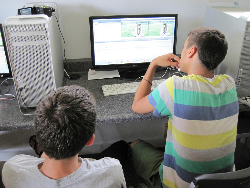 . Adin Feder (right) 15, and Ezzat Bder (right), 16, edit a video they made about youth and identity. The students are participating in the summer session of Artsbridge, hosted by Buxton School in Williamstown. The program uses art and dialogue to develop constructive partnerships between Israeli, Palestinian and American youth. Sunday, July 21, 2013 Jenn Smith/Berkshire Eagle Staff