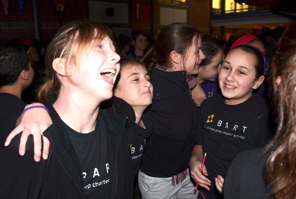 . BART students dance to \'Lean on me\' during a school wide assembly to launch an anti-bullying campaign at the school in Adams on Thursday, Jan. 30, 2014. From left are Hannah Supranowicz, 12, Bella Artioli, 11, and Deliah Shulman, 11. (Gillian Jones/Berkshire Eagle Staff)
