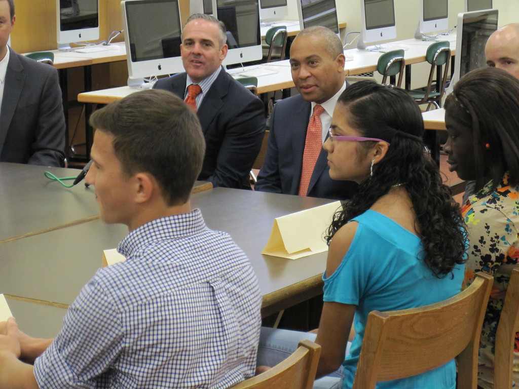 . State Sec. of Education Matthew Malone and Gov. Deval Patrick listen to Pittsfield High School students Monday during a roundtable forum held at the school. Jenn Smith/Berkshire Eagle Staff Monday, Oct. 7, 2013