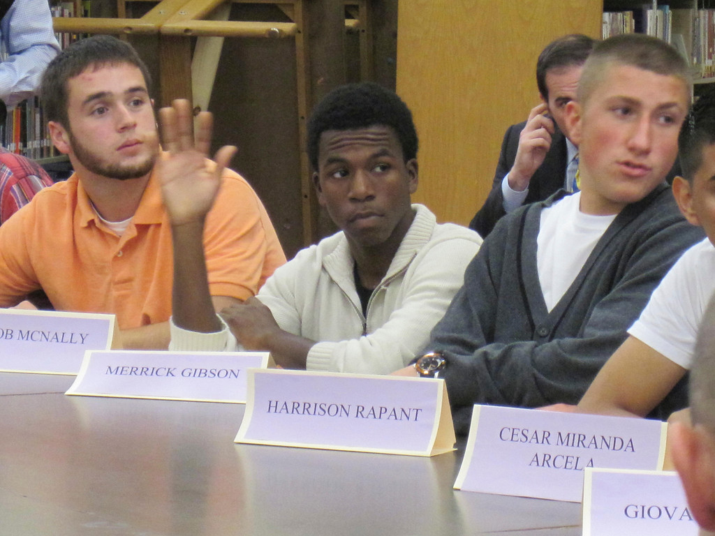 . Senior Merrick Gibson raises his hand to ask Gov. Deval Patrick a question Monday during a student roundtable with state and local diginitaries. Jenn Smith/Berkshire Eagle Staff Monday, Oct. 7, 2013
