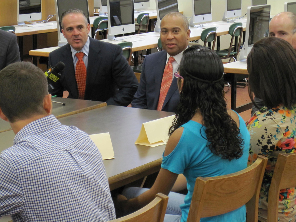. State Sec. of Education Matthew Malone and Gov. Deval Patrick listen to Pittsfield High School senior Gladys Garcia Monday during a roundtable forum held at the school. Jenn Smith/Berkshire Eagle Staff Monday, Oct. 7, 2013