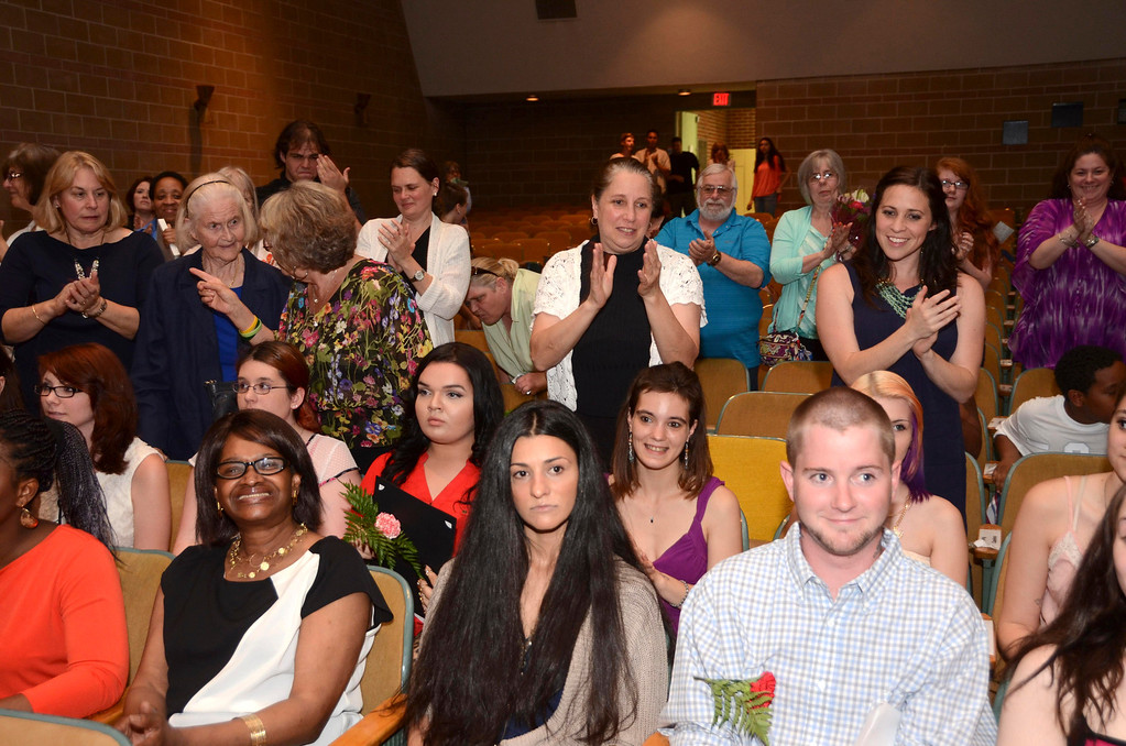 . Graduates of the Pittsfield Adult Learning Center are applauded by teachers, friends and relatives during a graduation and awards ceremony at Crosby Elementary School on Tuesday, June, 10, 2014. Gillian Jones / Berkshire Eagle Staff / photos.berkshireeagle.com