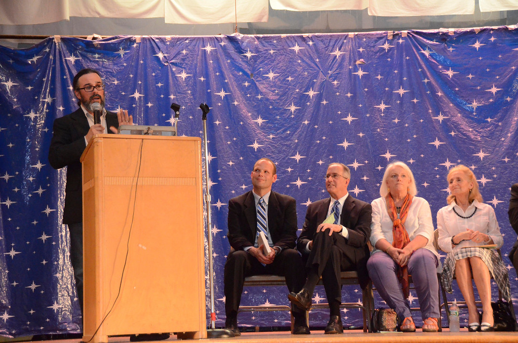 . David Christopolis, executive director of Hilltown CDC and PALC distinguished alumus speaker, gives his address during a graduation and awards ceremony at Crosby Elementary School on Tuesday, June, 10, 2014. Gillian Jones / Berkshire Eagle Staff / photos.berkshireeagle.com