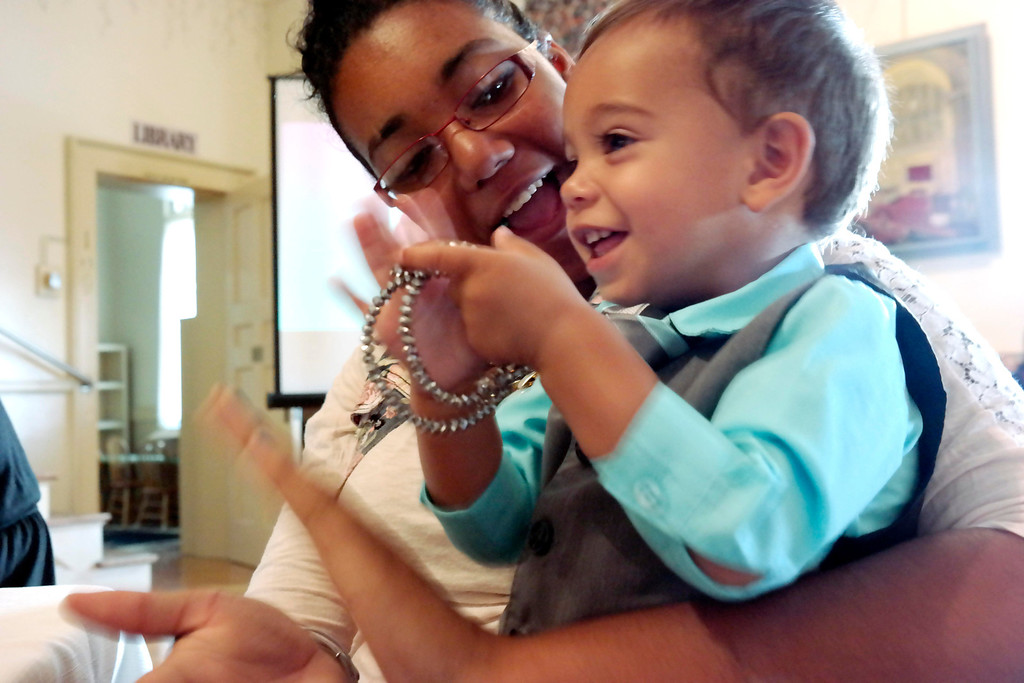 . Tatianna Apala and her Son Jaiiden Petersoli applaud at the Helen Berube Teen Parent Program commencement. Friday June 6, 2014.  Ben Garver / Berkshire Eagle Staff / photos.berkshireeagle.com