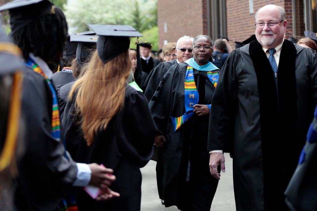 . North Adams mayor Richard Alcombright greets students as he enters the gymnasium for the MCLA commencement ceremony in North Adams. Saturday, May 17, 2014.