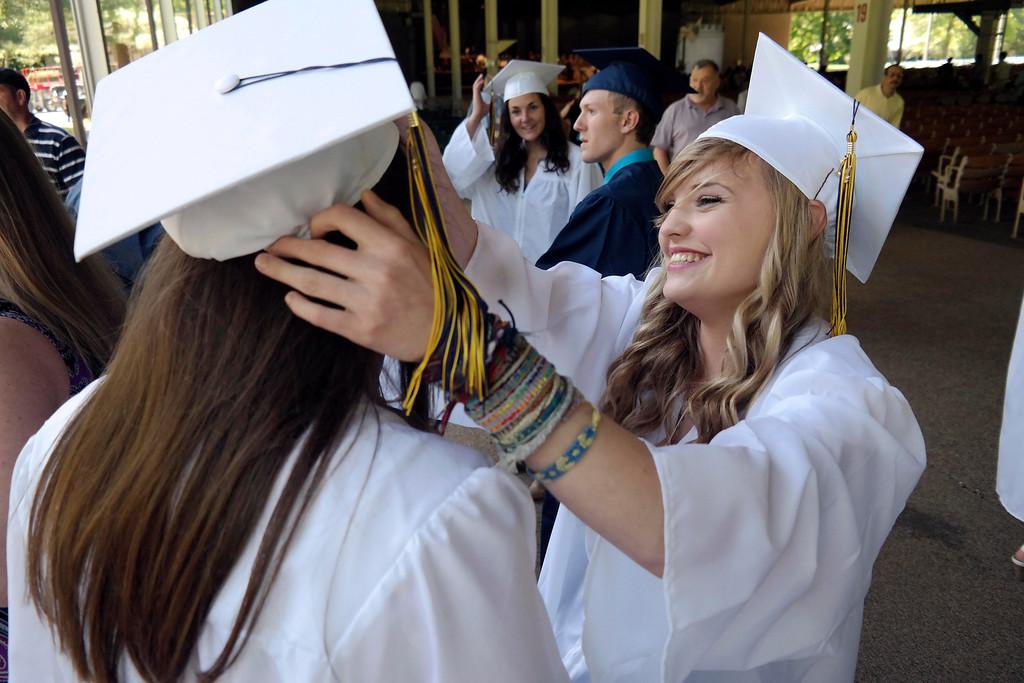 . Sabrina Van Deusen helps Alicia Bazonski with her cap at the Mount Everett School graduation at Tanglewood. Saturday June 7, 2014.  Ben Garver / Berkshire Eagle Staff / photos.berkshireeagle.com