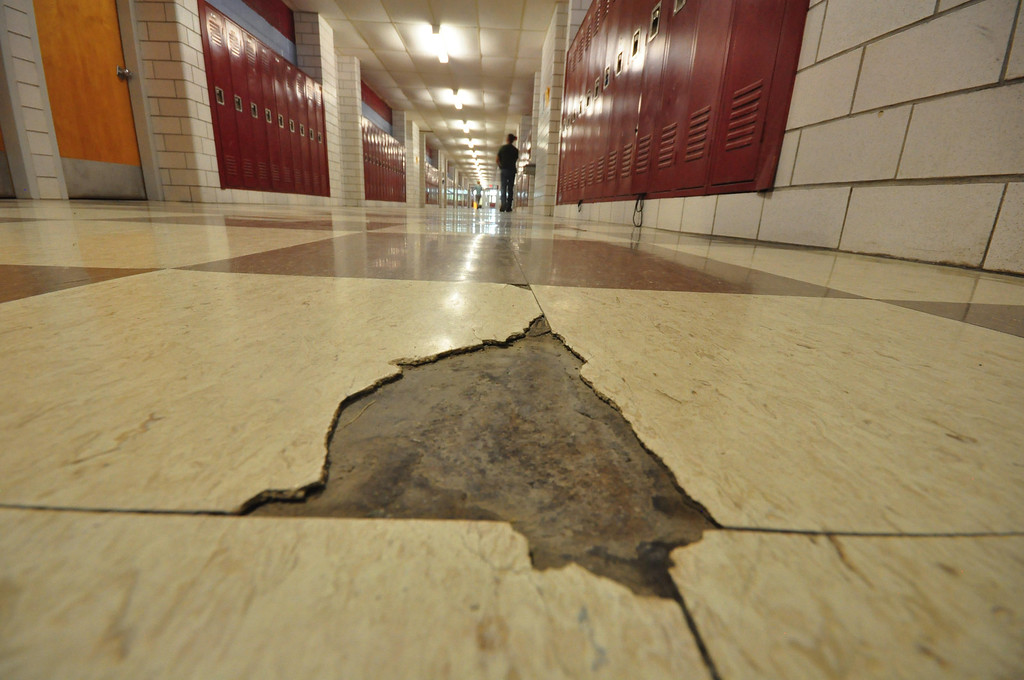 . The humidity and other climate control issues at Mount Greylock Regional High School, take a toll on the tiles of the floors, which are as old as the building in many areas. Gillian Jones / Berkshire Eagle Staff / photos.berkshireeagle.com