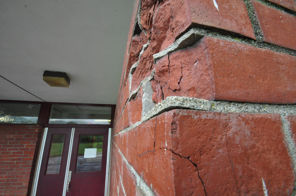 . The deteriorating brick at one of the entrances to Mount Greylock Regional High School in Williamstown. The school, which was built in 1960, and had an edition constructed in 1968, has much of the original equipment and building technology of that era.  Gillian Jones / Berkshire Eagle Staff / photos.berkshireeagle.com