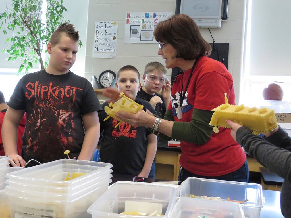 """. Seventh-grade science teacher Ellen Lantz gives students tips on improving the construction of their racing \""""pasta pods,\"""" as part of a physics lesson at Herberg Middle School in Pittsfield. Jenn Smith/Berkshire Eagle Staff/ photos.berkshireeagle.com Friday, March 7, 2014"""