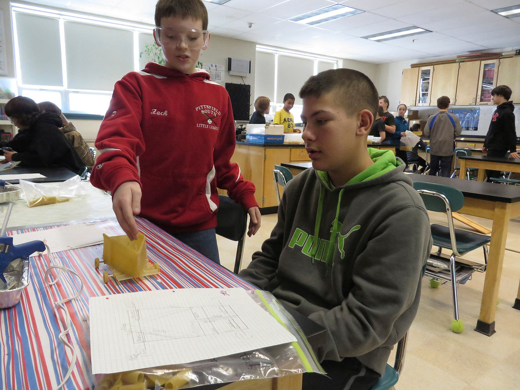 """. Herberg Middle School seventh graders Zack Zerbato (left) and Hunter Potash (right), discuss the design of their \""""pasta pod,\"""" a racing vehicle they created as part of a physics lesson. Jenn Smith/Berkshire Eagle Staff/ photos.berkshireeagle.com Friday, March 7, 2014"""