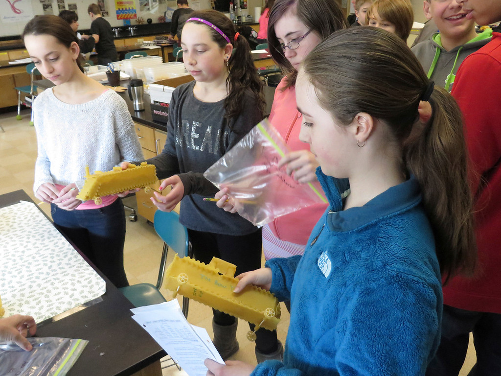 """. Herberg Middle School seventh graders discuss the designs of their \""""pasta pods,\"""" racing vehicles they constructed as part of a physics lesson. Jenn Smith/Berkshire Eagle Staff/ photos.berkshireeagle.com Friday, March 7, 2014"""