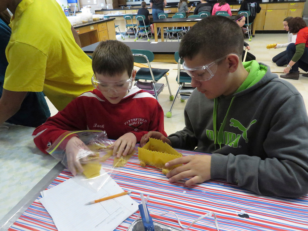 """. Herberg Middle School seventh graders Zack Zerbato (left) and Hunter Potash (right), work on designing their \""""pasta pod,\"""" a racing vehicle they created as part of a physics lesson. Jenn Smith/Berkshire Eagle Staff/ photos.berkshireeagle.com Friday, March 7, 2014"""