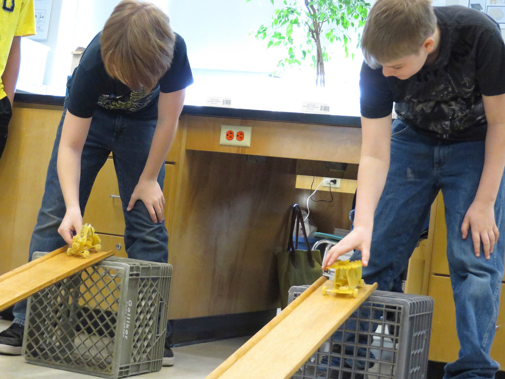 """. Herberg Middle School seventh graders Barret Brooking (left) and Anthony Funk (right), prepare to race their \""""pasta pods\"""" they constructed as part of a physics lesson. Jenn Smith/Berkshire Eagle Staff/ photos.berkshireeagle.com Friday, March 7, 2014"""