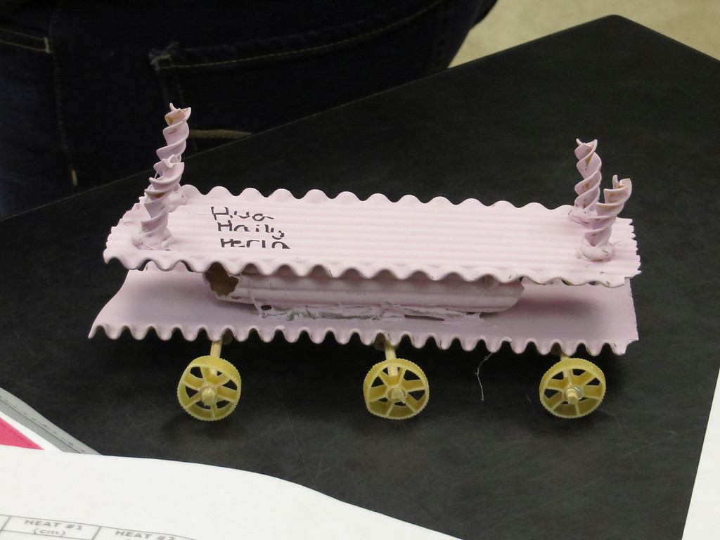 """. Herberg Middle School seventh graders Ava Bressette, Perla Rojas and Haily Sumner designed this \""""pasta pod,\"""" a racing vehicles they constructed as part of a physics lesson. Jenn Smith/Berkshire Eagle Staff/ photos.berkshireeagle.com Friday, March 7, 2014"""