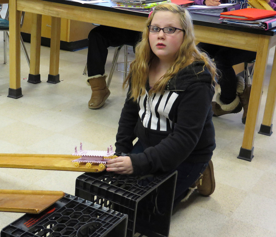 """. Herberg Middle School seventh grader Ava Bressette prepares to race a \""""pasta pod\"""" her group constructed as part of a physics lesson. Jenn Smith/Berkshire Eagle Staff/ photos.berkshireeagle.com Friday, March 7, 2014"""